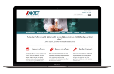Akiet Software Solutions on laptop screen.
